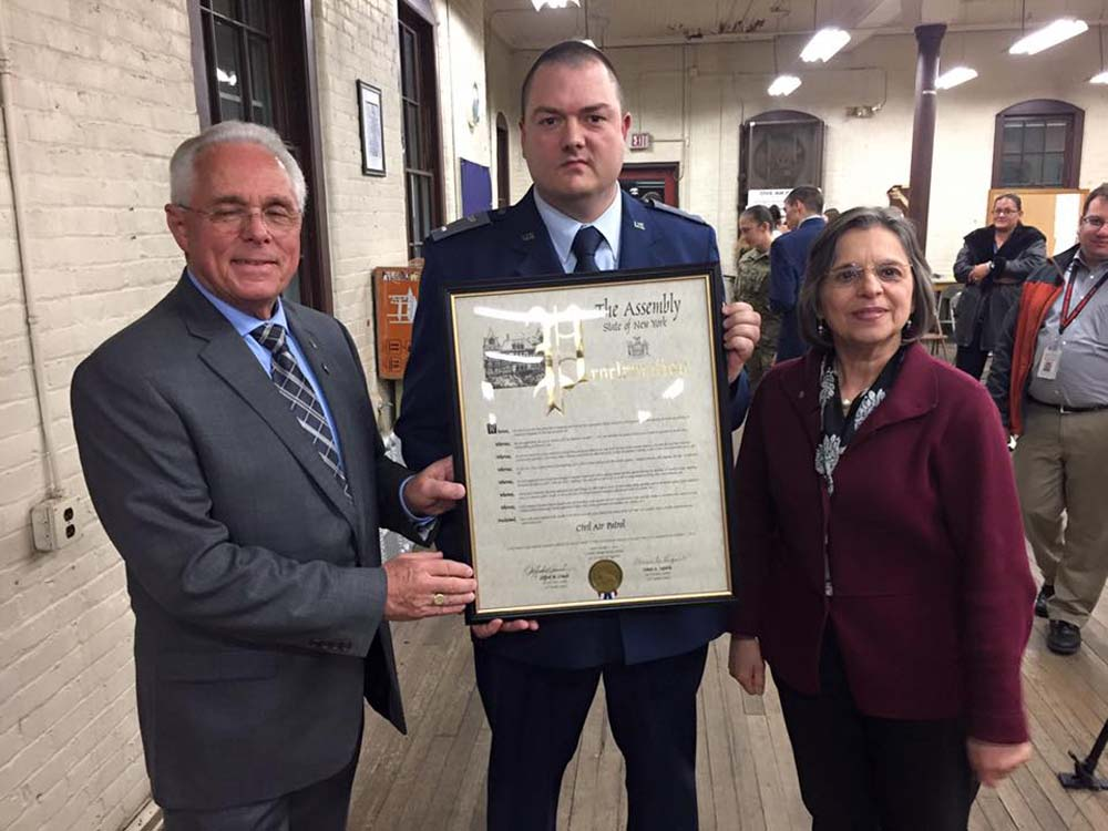 December 1, 2016 – Assemblywoman Lupardo and Assemblyman Cliff Crouch present a New York State Assembly Proclamation to Commander Franklin Birt of NY-292 in honor of the Civil Air Patrol's 75th Anniversary.<br />