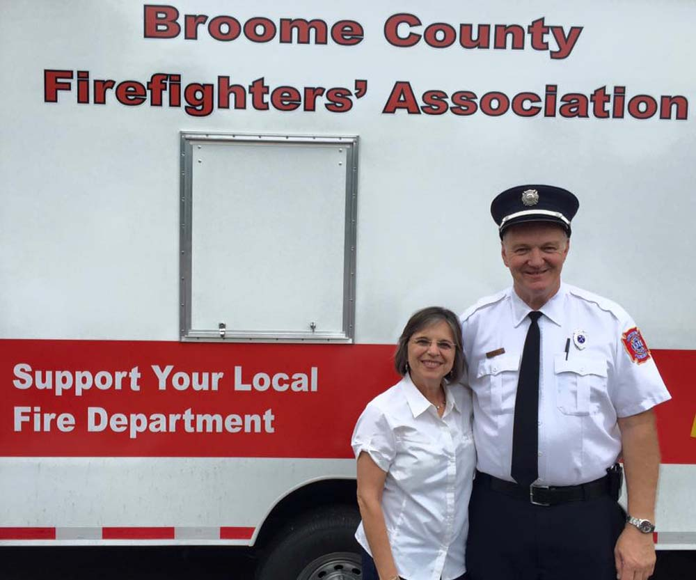 September 18, 2016 – Assemblywoman Lupardo and Rob Brady, President of the Broome County Firefighters Association at the dedication of BCFA's new safety trailer.<br />