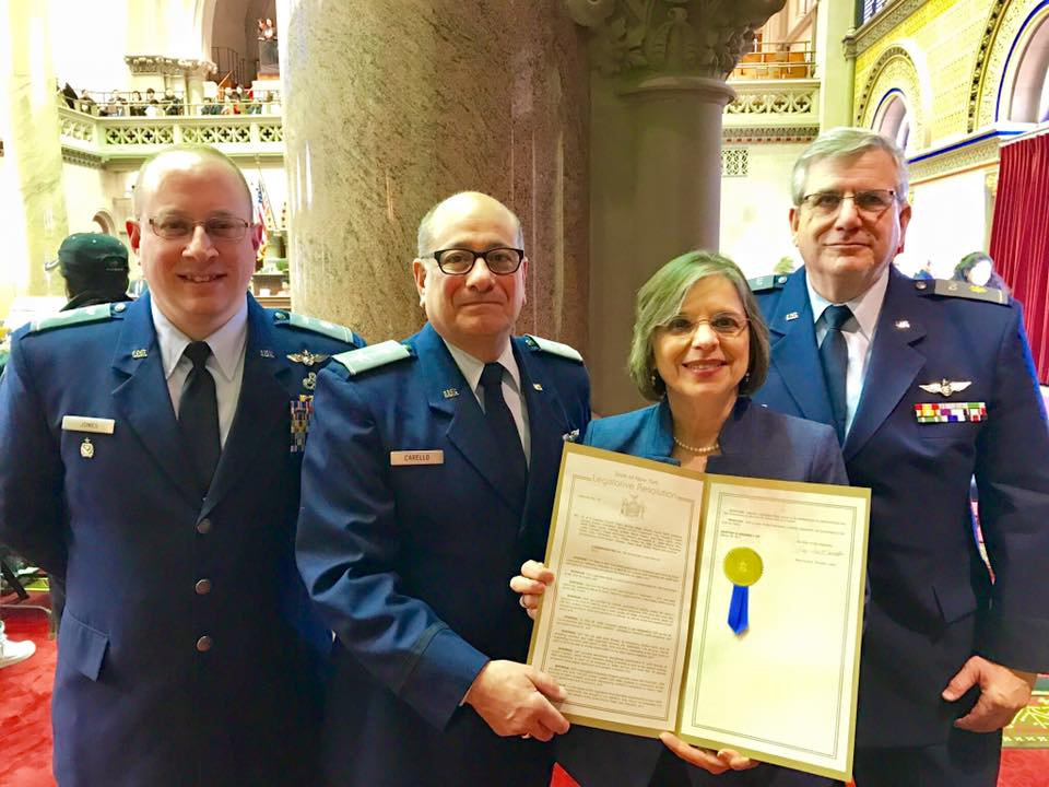 Members of New York Civil Air Patrol receive a proclamation from Assemblywoman Lupardo honoring the group's 75th anniversary.<br />
