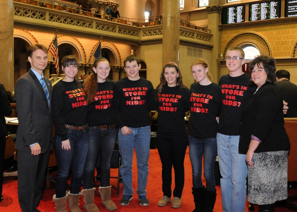 Pictured with Assemblyman Chris Friend (left) are Anna Evanek, Rachael Schweiger, Dakota Skinner, Annie Wainwright, Taylor Ayres, Dustin Sherman and Robin Baker, representatives and students from Reality Check Youth Group who work to combat tobacco use by their fellow students.