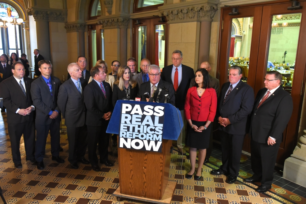 Assemblyman Christopher S. Friend (R,C,I-Big Flats) (second left) and Assembly Minority colleagues at a recent press conference calling for passage of real ethics reform.