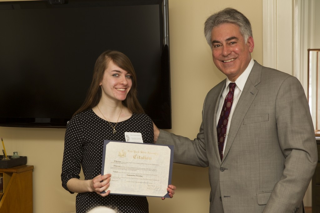 Assemblyman Stirpe awards Samantha Fleming for winning Women's History Month essay on Eleanor Roosevelt.