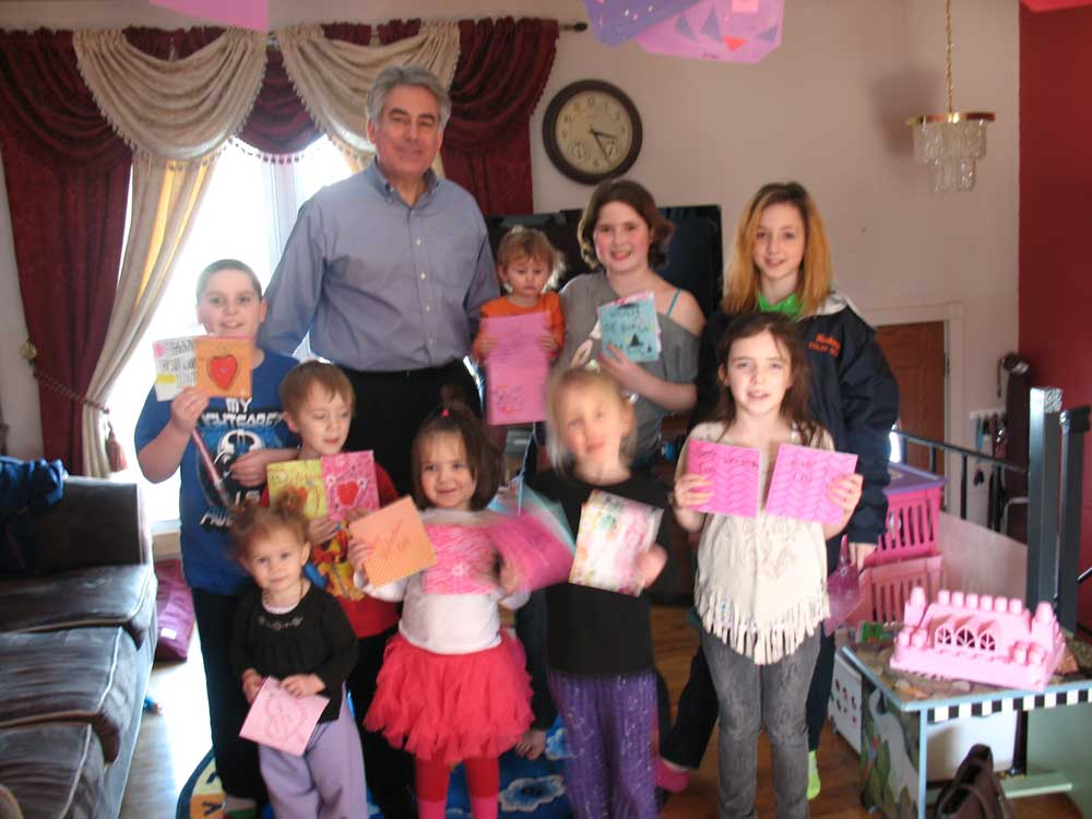 Assemblyman Stirpe with local children who made valentines for the area's veterans.