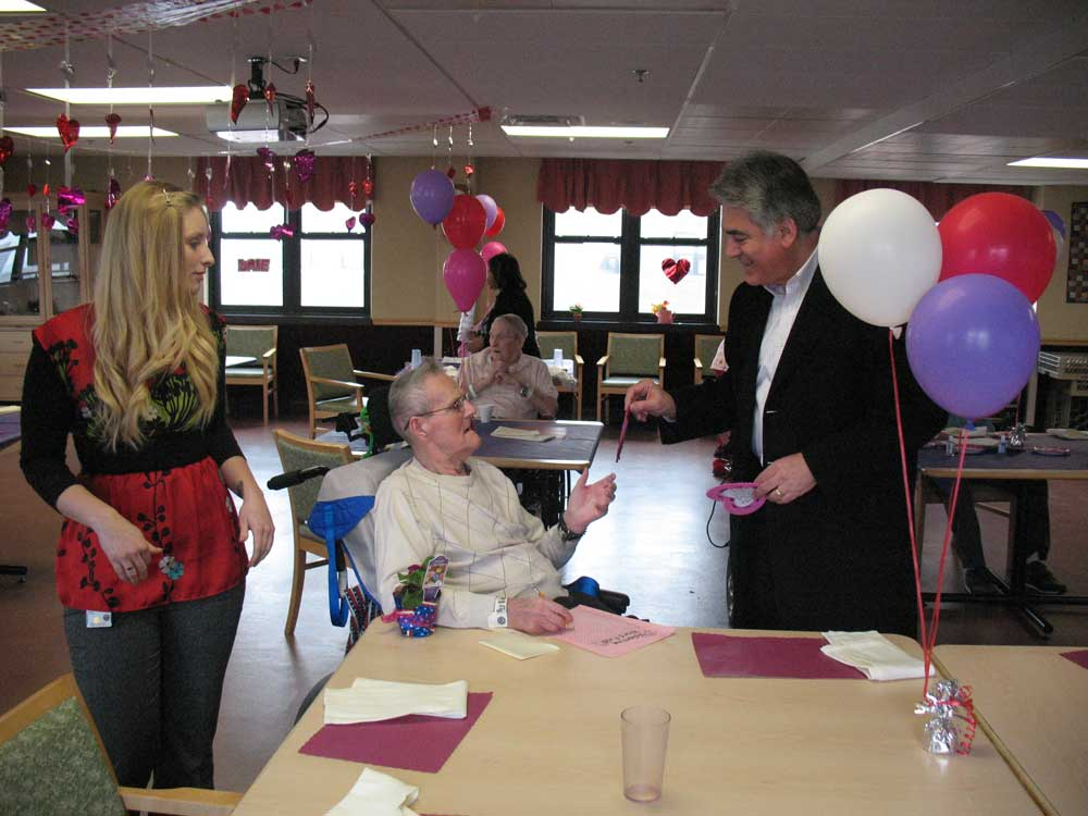 Assemblyman Stirpe handing out a valentine to a veteran at the Syracuse VA Hospital.