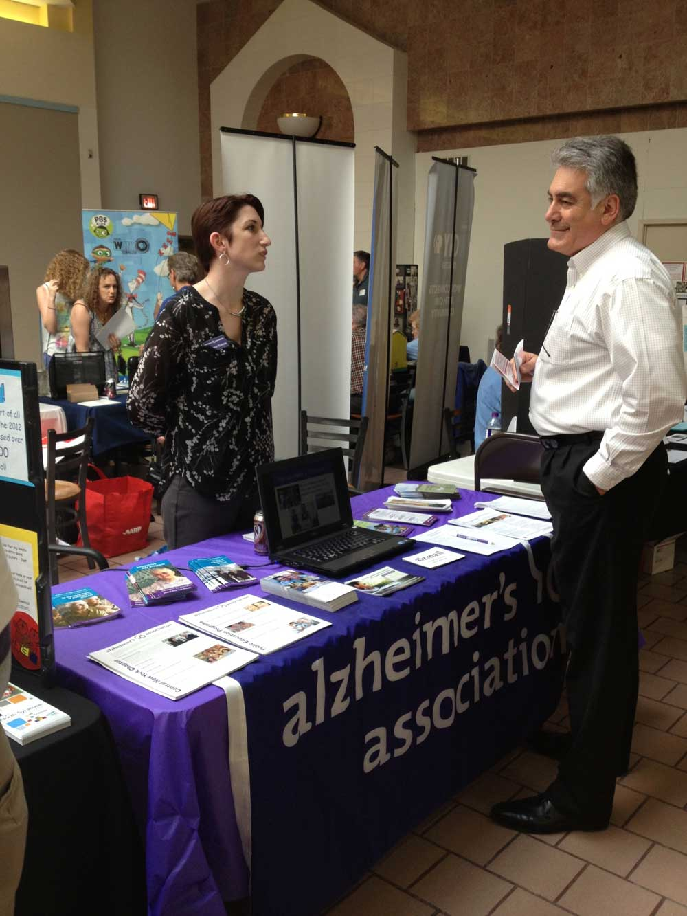 Assemblyman Stirpe stops by the Alzheimer's Association table at the Volunteer Fair he hosted.