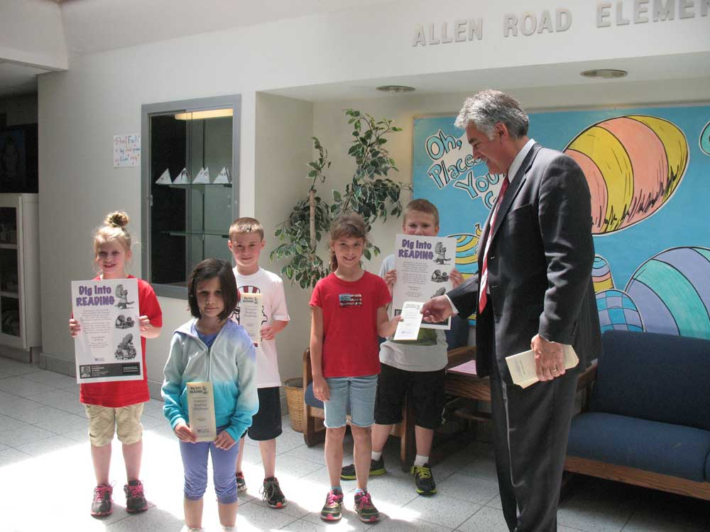 Assemblyman Stirpe visits Allen Road Elementary to hand out brochures for the 2013 NYS Assembly Summer Reading Challenge.