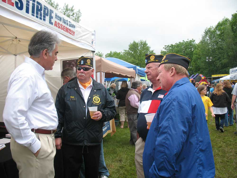 Assemblyman Stirpe talking to members of the James Harvey Spire American Legion Post 787- Cicero, at the Cicero Community Festival.
