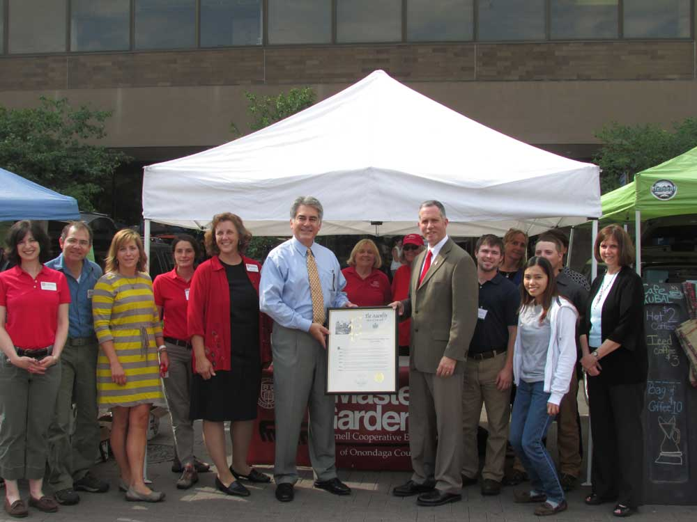 Assemblyman Stirpe presents a proclamation to David Skeval, Executive Director of Onondaga County Cornell Cooperative Extension and his staff, for their 100th year Anniversary.