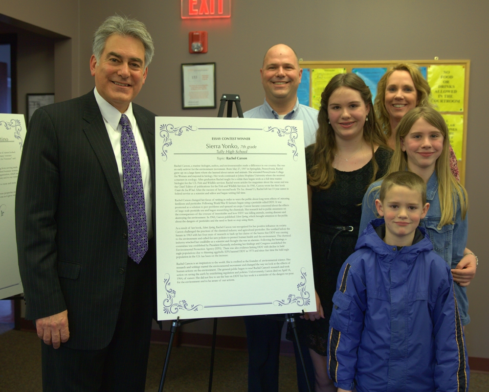 Assemblyman Al Stirpe joins Sierra Yonko, 7th grader at Tully High School, and her family to celebrate her being a 2014 Women of Distinction Essay Contest Winner.