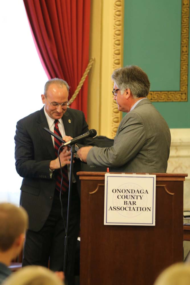Assemblyman Stirpe presents a Resolution recognizing May 1 as Law Day in New York to Nick DeMartino at the Onondaga County Court House