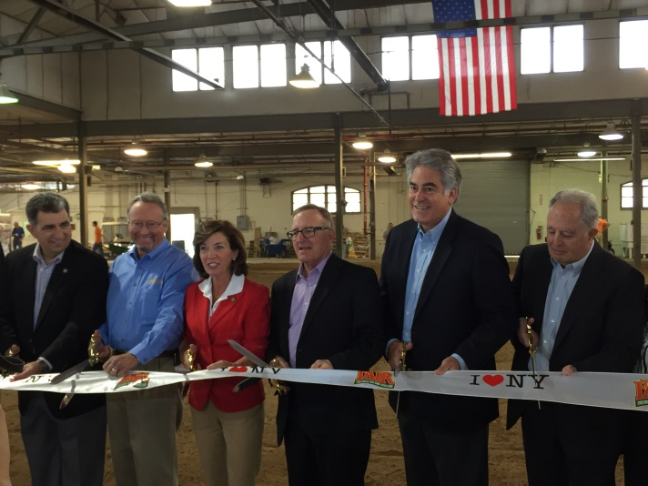 Assemblyman Stirpe cuts the ribbon at the New York State Fair with Lieutenant Governor Kathy Hochul.