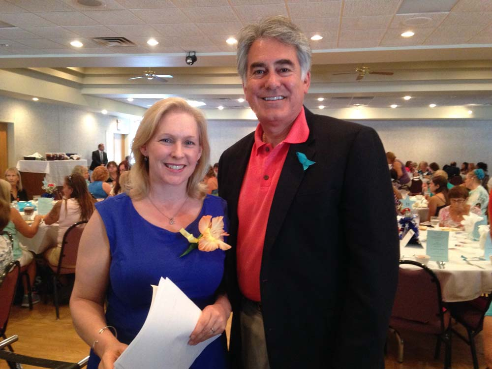 Assemblyman Al Stirpe with U.S. Sen. Gillibrand at the State Fair's 2015 Women's Day Luncheon.