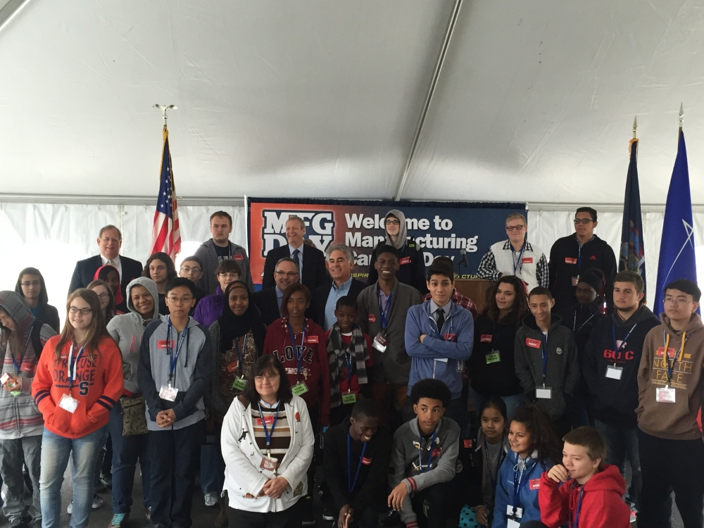 Assemblyman Al Stirpe celebrates Manufacturing Day 2015 with local high school students interested in manufacturing trade jobs. Also in the photo, Lockheed Martin's Mike Ernenwein and MACNY President Randy Wolken, who jointly hosted this year's Manufacturing Day events.