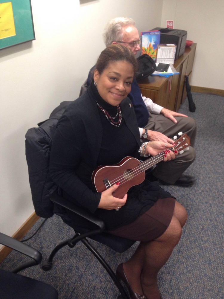 During a visit to the Liverpool Library, Assemblymember Pamela Hunter learned that not only can you borrow books from the library but the loan out musical instruments like this ukulele.