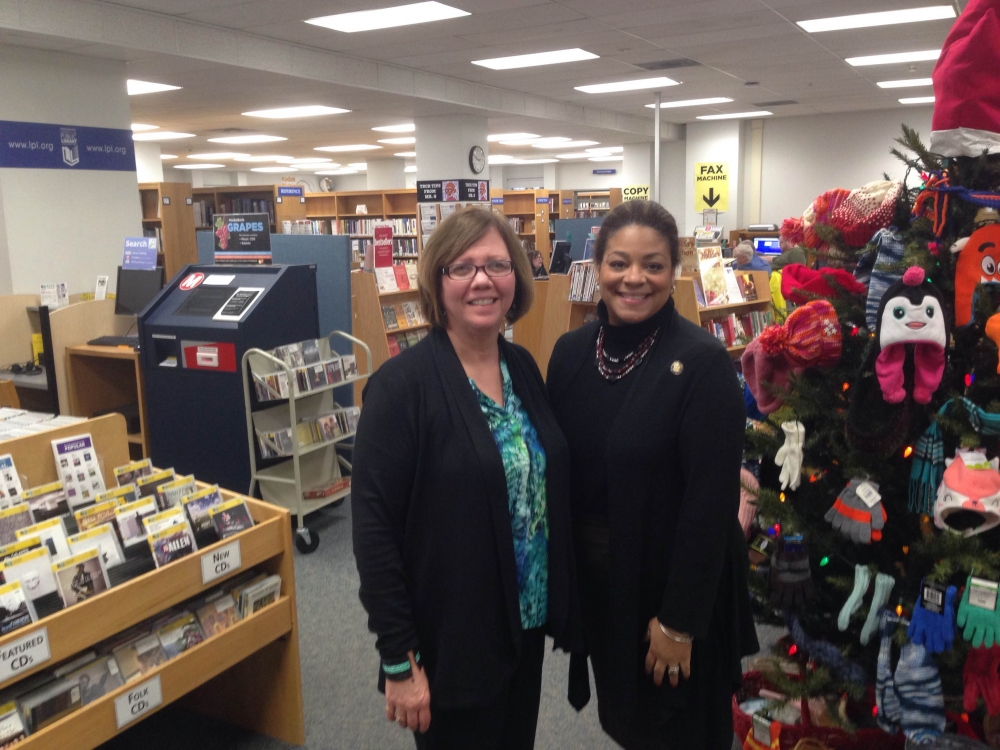 Assemblymember Pamela Hunter and Glenna Wisniewski, director of the Liverpool Library, meet during a stop in Liverpool.