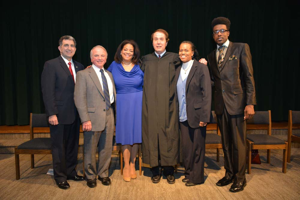 Assemblymember Pamela J. Hunter is joined by Assemblyman William Magnarelli, David Kirby, Political Action Coordinator at NYSUT, who also acted as Master of Ceremonies, Onondaga County Family Court Judge Honorable Michael Hanuszczak, Sharon Owens, President & CEO, Syracuse Model Neighborhood Facility, Inc., and Rev. Vernon Williams, Jr. of Bellgrove Missionary Baptist Church at her swearing in which took place at Le Moyne College on December 29, 2015.