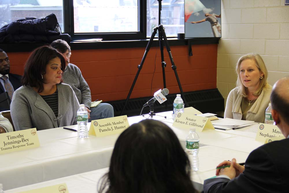 Assemblymember Pamela J. Hunter and Senator Kirsten Gillibrand discuss issues of gun trafficking at a roundtable at the Southwest Community Center in Syracuse on January 15, 2016
