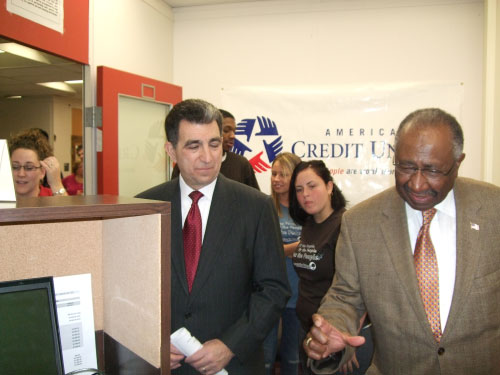 Assemblyman Magnarelli and City Council President Van B. Robinson take a tour of �Falcon Trust,� the new community credit union at Fowler High School. The branch will be operated by students, in partnership with Cooperative Federal.