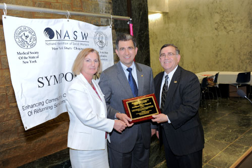 Assemblyman Magnarelli received a plaque from the National Association of Social Workers Executive Director, Reinaldo Cardona and Eileen Clinton, Program Coordinator, MSSNY (Medical Society of the State of New York). The National Association of Social Workers New York State Chapter honored Assemblyman Magnarelli with a reception for sponsoring legislation that addresses the lack of integrated mental health and substance abuse services for veterans returning from combat.