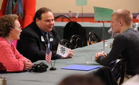 Assemblyman Palmesano speaking with Joel Rosko and his mother, Regina, at the 4-H Legislative Breakfast.