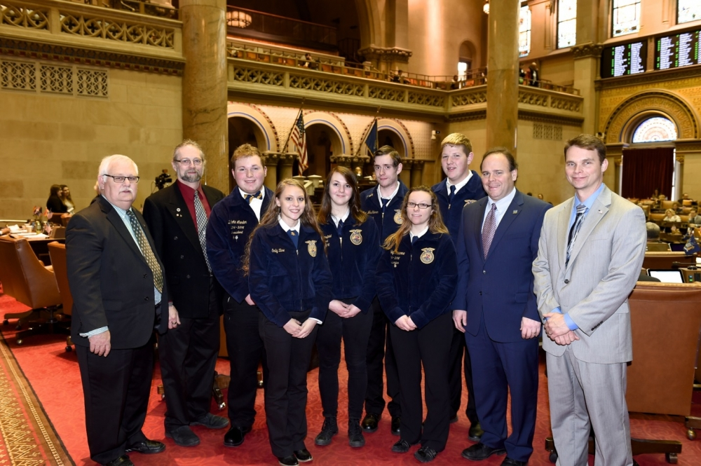 President of the NYS Association of Conservation Districts Dan Farrand and GST BOCES Conservation Instructor and FFA Advisor Dan MacNaughton are pictured on the left. On the right are Assemblyman Phil Palmesano and Assemblyman Chris Friend. Between the gentlemen is a group of FFA students, including Miranda Stansfield � Horseheads High School, Ashley Materne- Horseheads High School, Dakota London � Watkins Glen High School, Emily Zine � Horseheads High School, Kyle Frasier � Odessa Montour High School and Nathan H Washburn � Elmira High School.