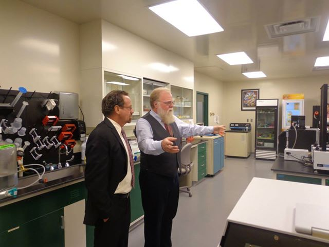Assemblymember Bronson was invited to tour OyaGen, a local biotechnology company focused on developing drugs for infectious diseases and cancer. [Pictured: Dr. Harold Smith, OyaGen�s founder and CEO].