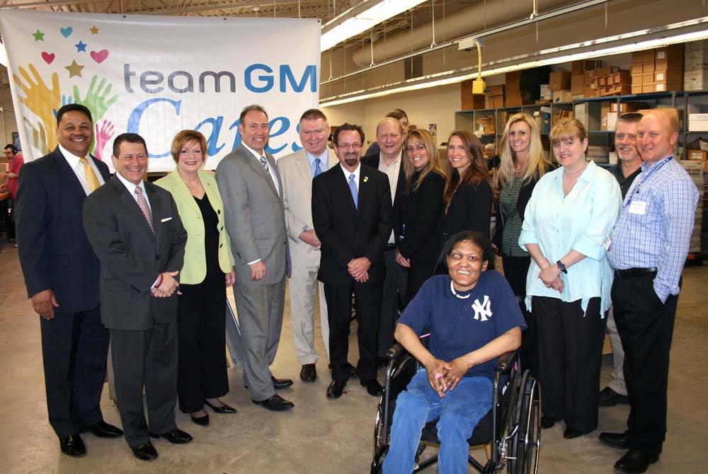Assemblyman Bronson along with local leaders thanking representatives from General Motors Components-Rochester and United Auto Workers for their generous grant to United Way of Greater Rochester, Holy Childhood, and Junior Achievement.