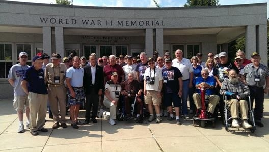 Assemblyman Steve Hawley (R,C,I-Batavia) poses with veterans and their family members at the World War II Memorial in Washington D.C. during the 2014 Patriot Trip.