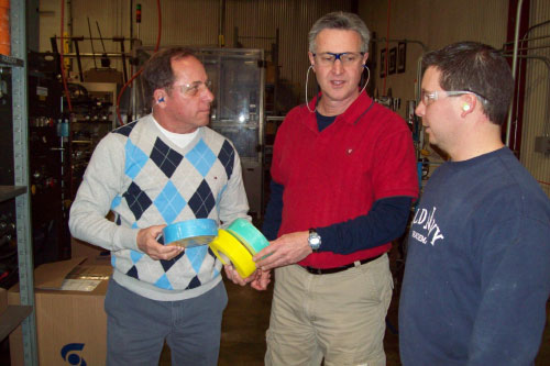 Assemblyman Steve Hawley (left) speaks with Saint-Gobain Operations Manager David Fink and set-up operator Mike Hanlon (right).