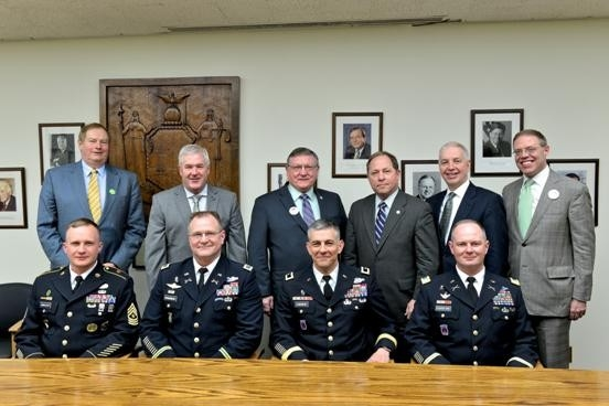 Assemblyman Steve Hawley (R,C,I-Batavia) (pictured third from the right) talked with members of New York's Fort Drum military base in Albany Tuesday.