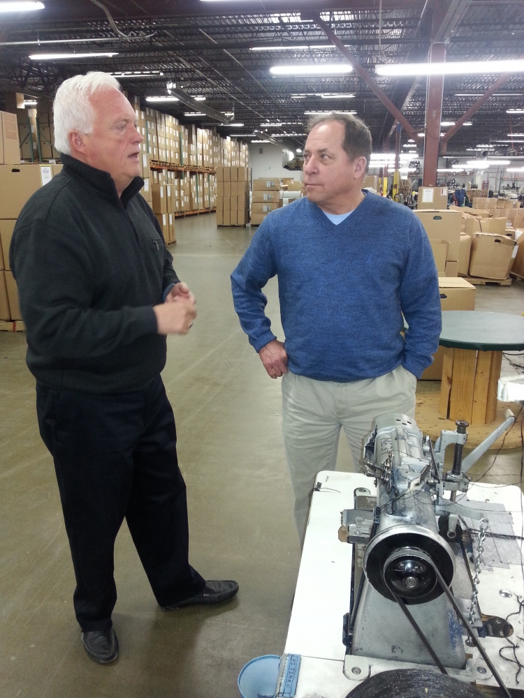 Assemblyman Steve Hawley (R,C,I-Batavia) (pictured right) discusses manufacturer techniques and machinery with Hinspergers General Manager Greg Budd as he continues his districtwide small-business tour on Friday by visiting Hinspergers Poly Industries Inc.'s plant in Medina. The Canadian-based company, which has manufactured swimming pool covers and related products since 1976, has been growing and expanding since it opened in Medina in 2002.