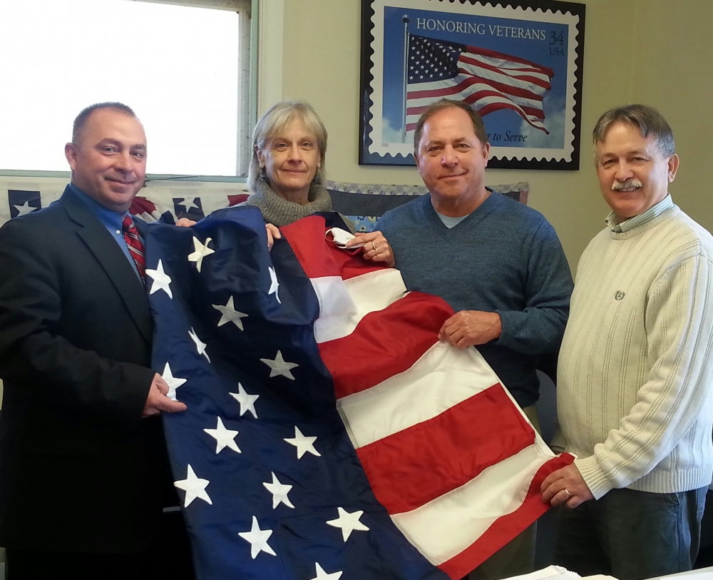 Assemblyman Steve Hawley (R,C,I-Batavia) (second from right) is pictured with Orleans County Veterans Service Agency Director Earl Schmidt (far left), the agency's Secretary Mary Jo Syck, and Orleans County Legislator Don Allport (far right). The assemblyman recently presented the new Veterans Service Agency Director with an American Flag and New York State Flag to display on the agency's flagpole that was donated by Hawley and former Sen. George Maziarz several years ago.