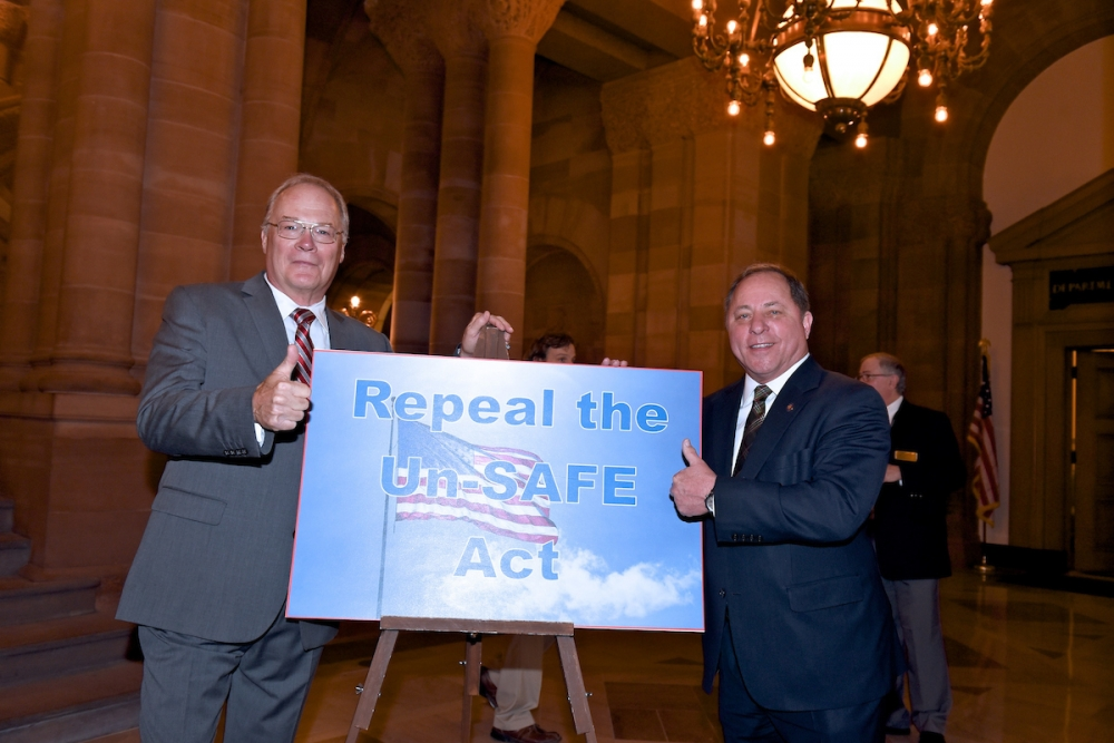Assemblyman Steve Hawley (R,C,I-Batavia) [right] poses for a photo with New York State Rifle and Pistol Association President Tom King at today's press conference in Albany<br />