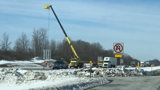 Construction crews along the Thruway repair 'I Love NY Signs' after last week's wind storm.<br />