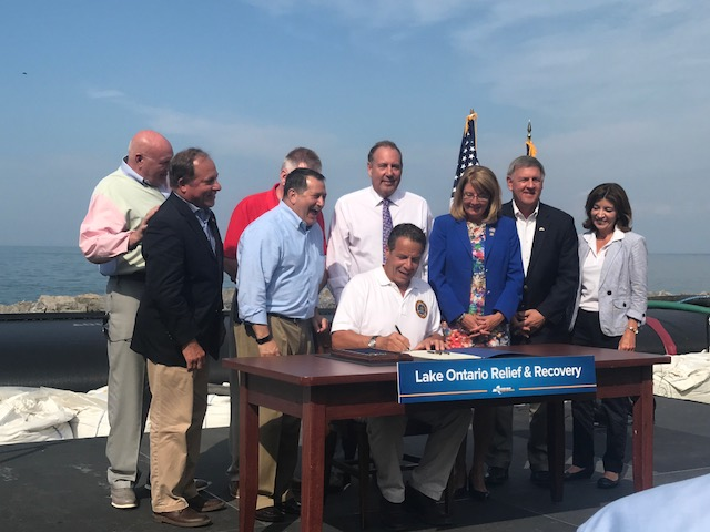 Assemblyman Steve Hawley (R,C,I-Batavia), second from the left, joins Gov. Cuomo and legislators in Irondequoit to sign a $45 million Lake Ontario relief bill into law.<br />