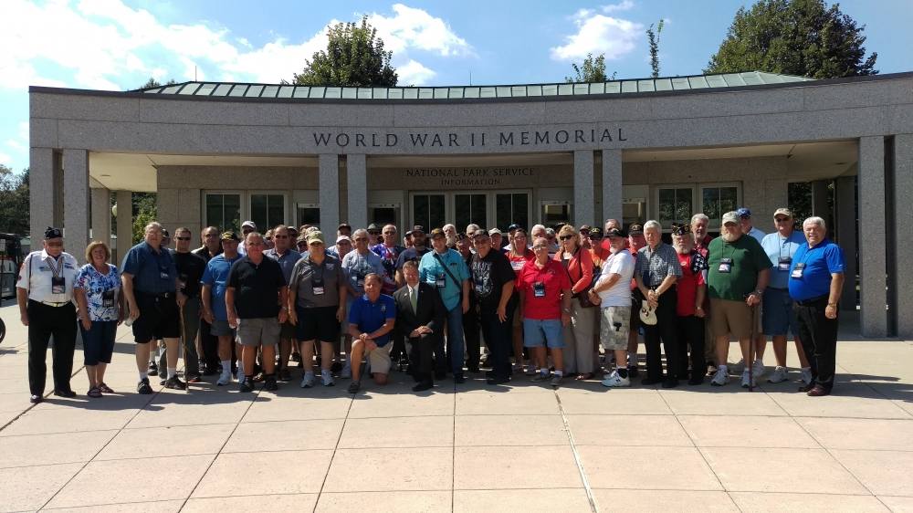 Assemblyman Steve Hawley (R,C,I-Batavia) poses with veterans and their family members in front of the World War II Memorial in Washington D.C. during a previous year's Patriot Trip  <br /> <br />