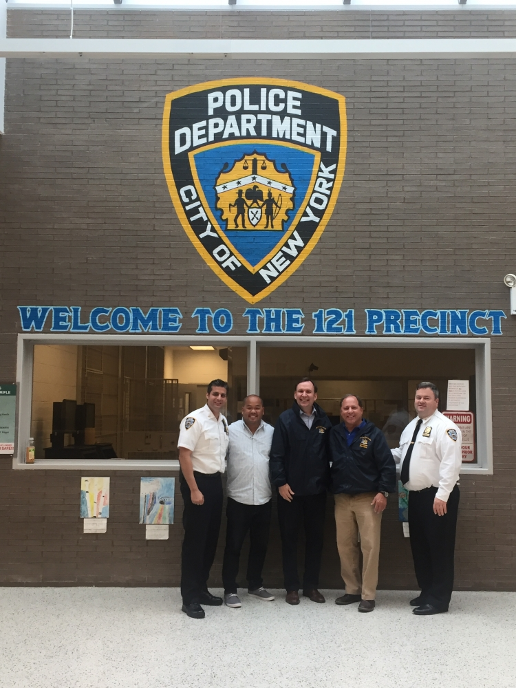 Assemblyman Steve Hawley (R,C,I-Batavia) and Assemblyman Michael Cusick (D-Staten Island) visit a local NYPD precinct on Staten Island and pose with local law enforcement members.<br />