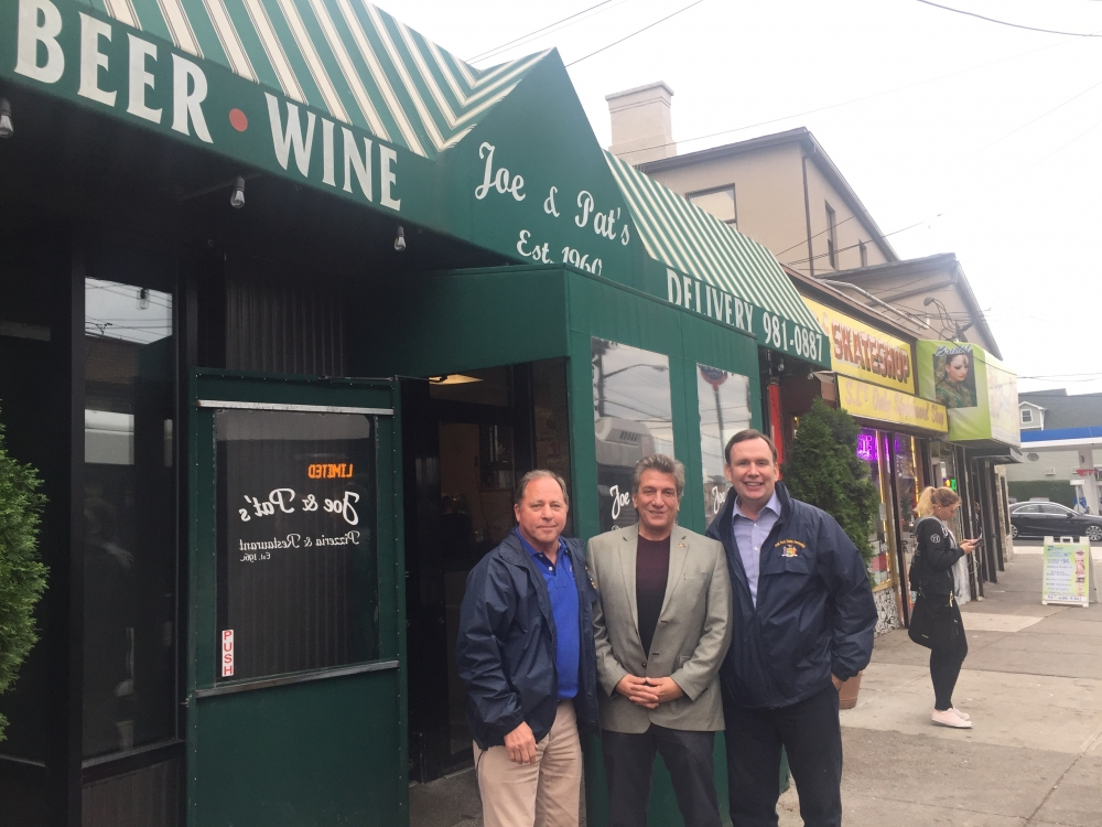 Assemblyman Steve Hawley (R,C,I-Batavia) [left], Assemblyman Matt Titone (D-Staten Island)[center], and Assemblyman Michael Cusick (D-Staten Island) [right] grab lunch at Joe & Pat's Pizza on Staten Island, a local staple.<br />