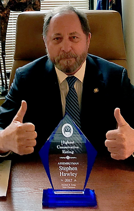 Assemblyman Steve Hawley (R,C,I-Batavia) poses with his Award as one of the most conservative members of the Assembly for 2017<br />