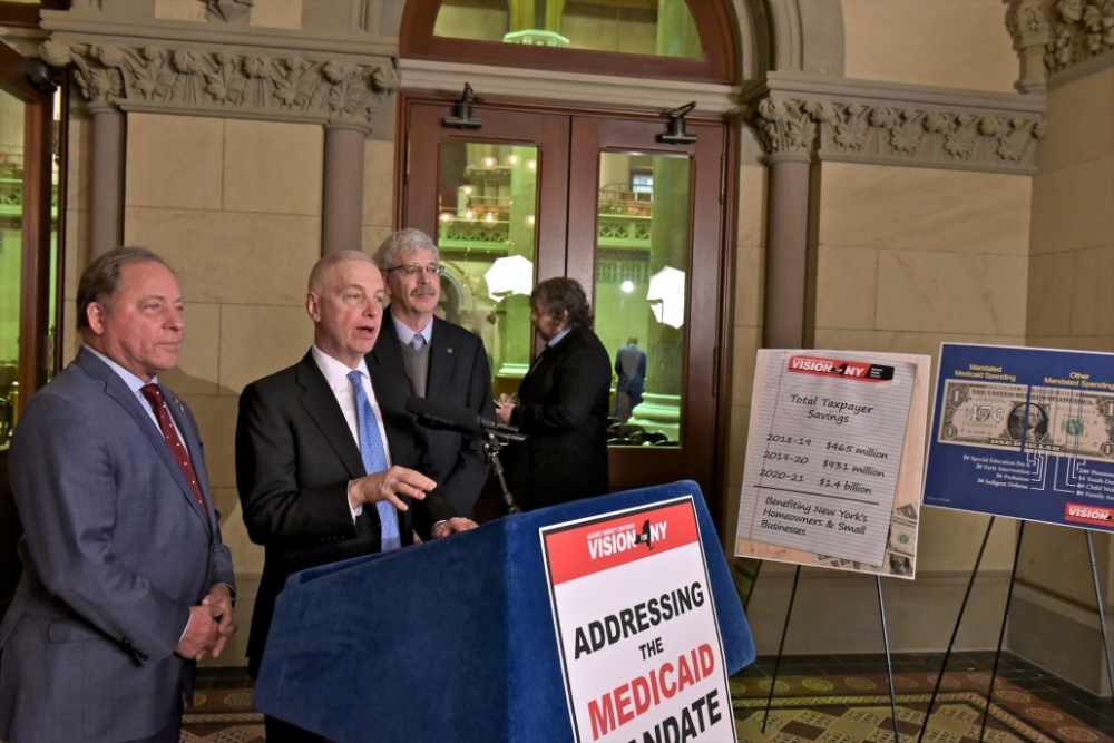 Assemblyman Steve Hawley (R,C,I-Batavia) [left] joins members of the Assembly Minority Conference to unveil a plan requiring a ten year state takeover of Medicaid costs<br />&nbsp;