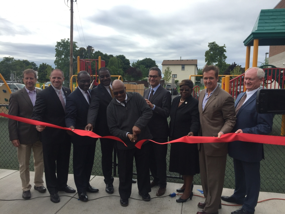 September 30, 2016 – Assemblywoman Peoples-Stokes stands with colleagues in government, community leaders the ribbon cutting ceremony for The Bellamy Commons. The affordable housing mixed use developm