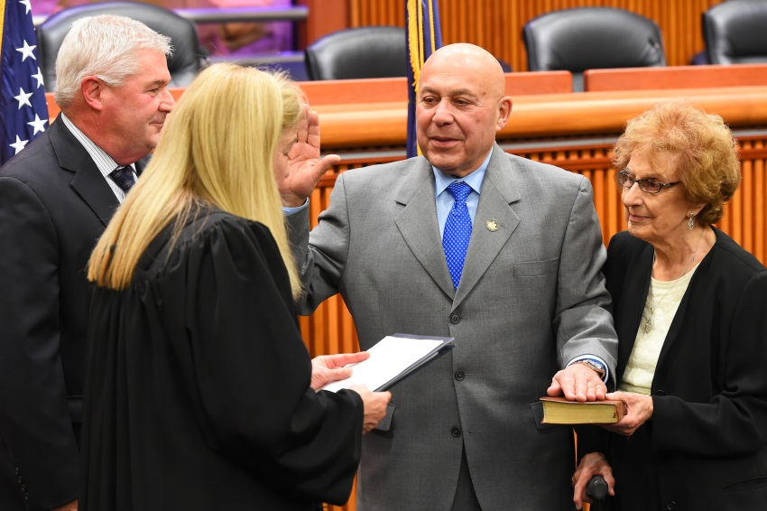 Assemblyman Angelo Morinello joined by his mother in taking his oath of office.<br />