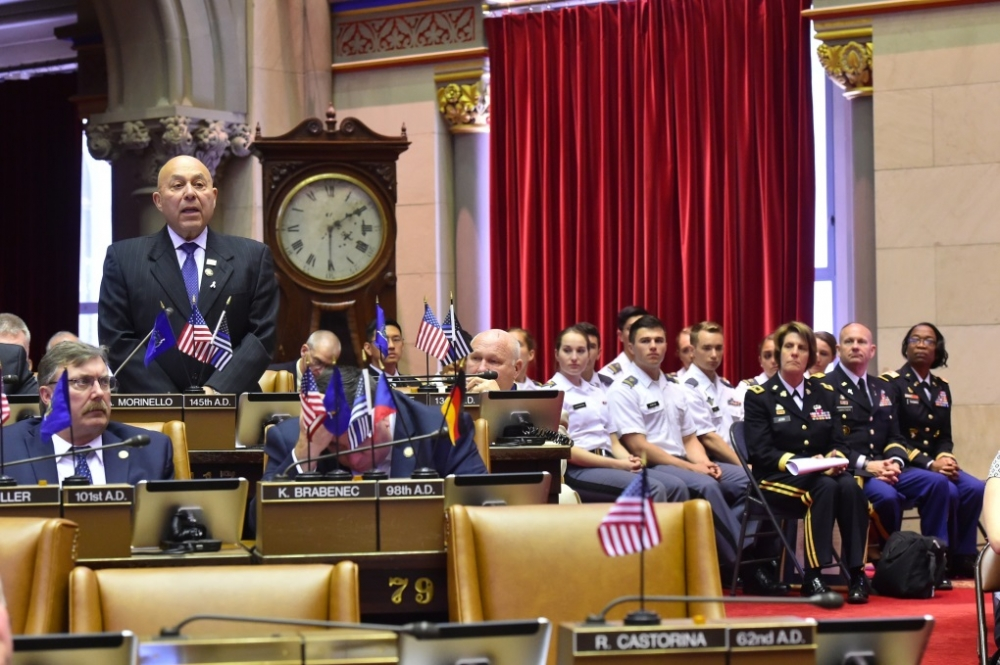 Assemblyman Angelo J. Morinello (R,C,I-Ref-Niagara Falls) speaking in the assembly chambers about 'West Point Day'.