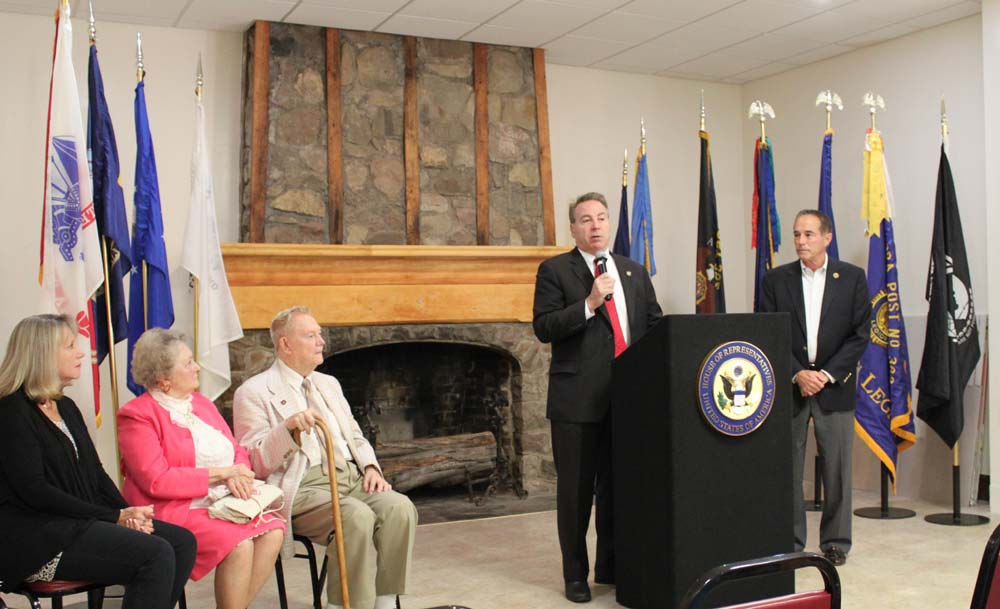 Assemblyman David DiPietro (R,C-East Aurora) addresses the audience as he joined Congressman Chris Collins (right) at the East Aurora American Legion to award Marine Corps Veteran Donald E. Schmidle (