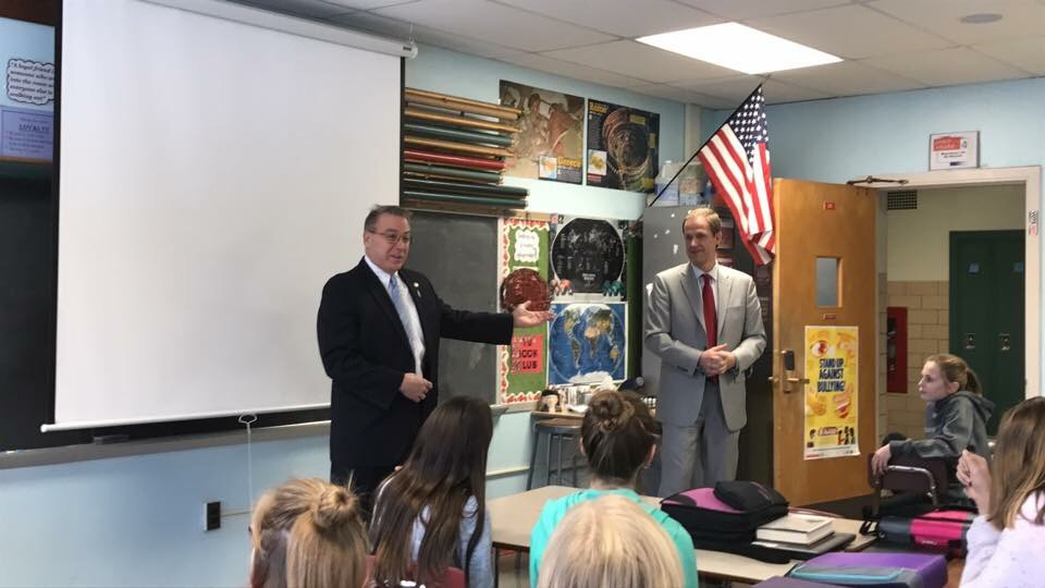 Assemblyman David DiPietro (R,C,I-East Aurora) and Sen. Patrick Gallivan explain their school supply bill to Mr. Minnuto's sixth grade class at Iroquois Middle School on December 21, 2017.<br />