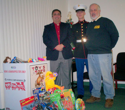 Assemblyman Giglio poses with volunteers of the Marine Corps. Toys for Tots program in his District Office.