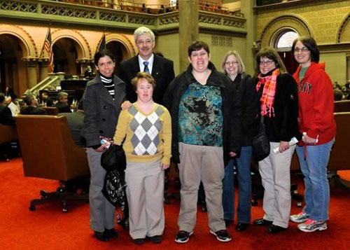 Julie Vogan, Assemblyman Andy Goodell, Jennifer Yost, Linda Bascom, Melissa Klenke, Karen Silzle and Heather Courtney meet in the Assembly Chamber at the Capitol.