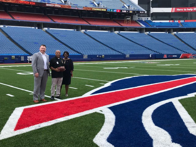 Pictured with Speaker Heastie at New Era Field is (from left to right): Assemblyman Pat Burke and Assembly Majority Leader Crystal Peoples-Stokes.